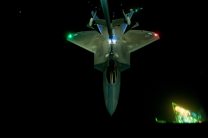 A U.S Air Force KC-10 Extender refuels an F-22 Raptor fighter aircraft prior to strike operations in Syria, Sept. 26, 2014. These aircraft were part of a strike package that was engaging ISIL targets in Syria. (U.S. Air Force photo by Tech. Sgt. Russ Scalf)