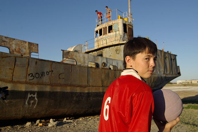 Children play on a derelict boat in the former Aral Sea port of Aralsk (Reuters / Aziz Mamirov)