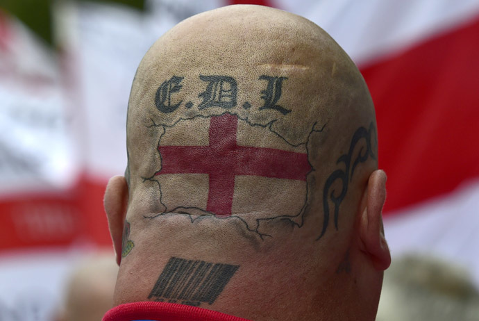Tattoos are seen on the back of the head of a supporter of the English Defence League (EDL) during a rally outside Downing Street in London September 20, 2014. (Reuters/Toby Melville)