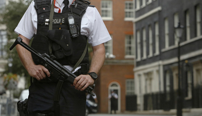 An armed police officer is seen on duty in Downing Street, central London September 1, 2014. (Reuters/Luke MacGregor)