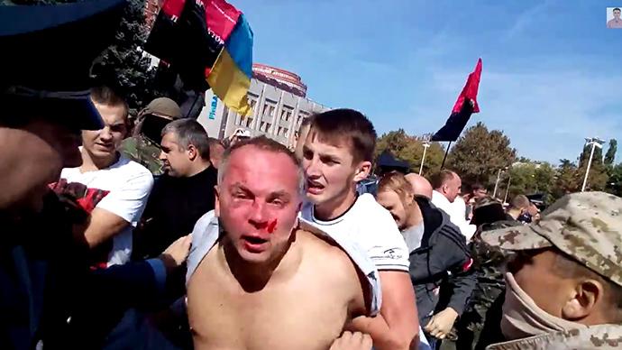 'Over my dead body': Defiant Ukrainian MP beaten by nationalist mob (VIDEO)