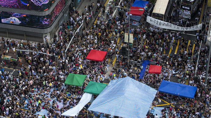 Hong Kong police pepper spray protesters as hundreds try to surround govt office