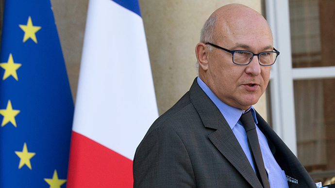 France sets new budget, rejecting German austerity plan