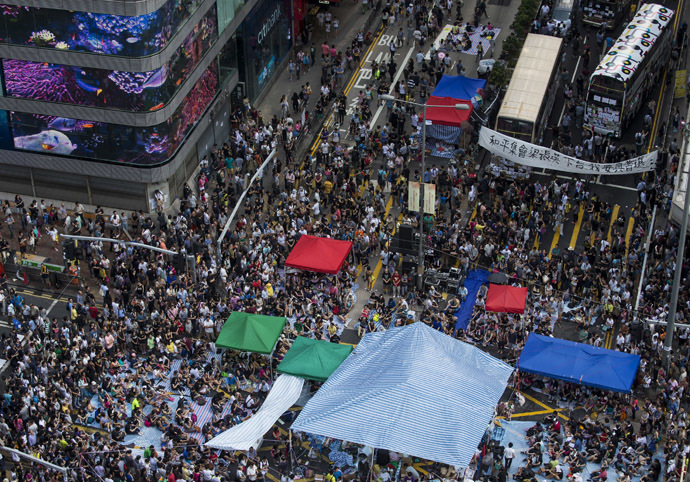 Buses covered with messages of support stop at a main street at Mongkok shopping district after thousands of protesters blocked the road in Hong Kong October 1, 2014. (Reuters/Tyrone Siu)