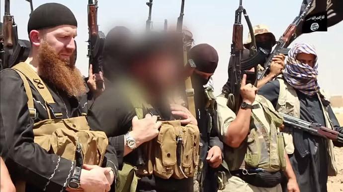 An image made available by Jihadist media outlet al-Itisam Media on June 29, 2014, allegedly shows members of the IS (Islamic state) including military leader and Georgian native, Abu Omar al-Shishani (Tarkhan Batirashvili) (L) and ISIL sheikh Abu Mohammed al-Adnani (C), (AFP Photo / HO / Al-Itisam Media)