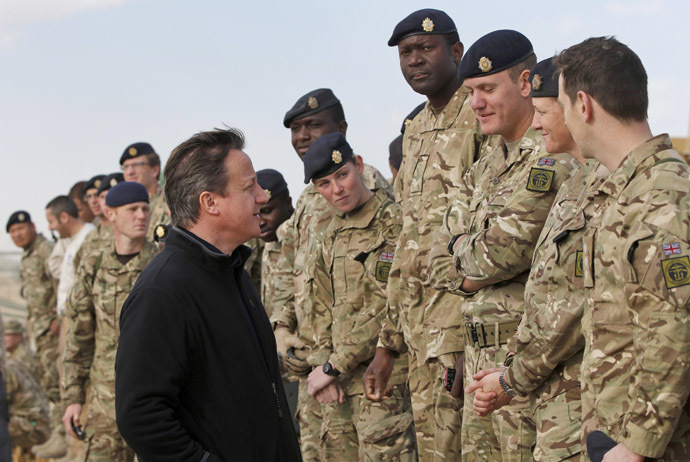 Britain's Prime Minister David Cameron speaks to British soldiers at Camp Bastion, outside Lashkar Gah, in Helmand province, southern Afghanistan December 16, 2013. (Reuters/Lefteris Pitarakis)