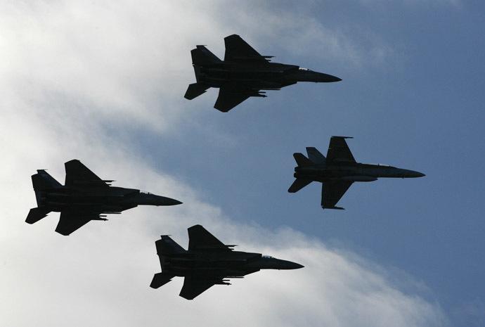 A Royal Australian Air Force F/A-18 Hornet and three US Oregon Air National Guard F-15C Eagle (Reuters/Daniel Munoz)