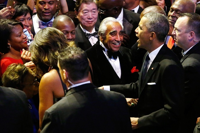 US Rep. Charlie Rangel (D-NY) (C) smiles as President Barack Obama (2nd R) and first lady Michelle Obama (2nd L, back to camera) greet members of the audience at the Congressional Black Caucus Foundation dinner. (Reuters/Jonathan Ernst )