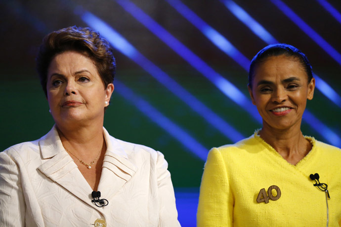 Brazil's presidential candidates Dilma Rousseff (L) of Workers Party (PT) and Marina Silva of Brazilian Socialist Party (PSB) take part in a TV debate in Rio de Janeiro October 2, 2014. (Reuters/Ricardo Moraes)