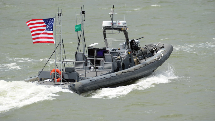The US Navy's unmanned 11-metre rigid hulled inflatable boat operates autonomously during a demonstration of swarmboat technology.(AFP Photo / John F. Williams )