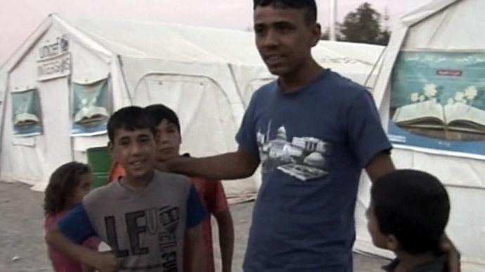 Inside Baharka refugee camp: RT talks to Iraqi survivors of ISIS attacks