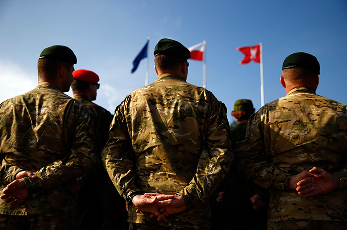"Participants stand during the opening ceremony of ""Noble Sword-14"" NATO international tactical exercise at the land forces training centre in Oleszno, near Drawsko Pomorskie, northwest Poland September 9, 2014 (Reuters / Kacper Pempel)"