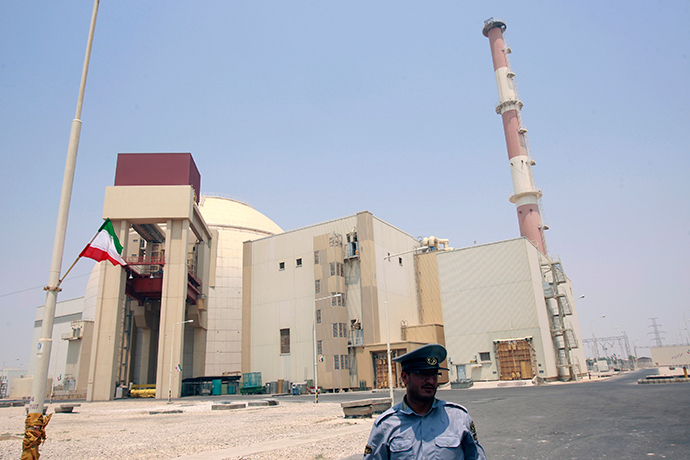 A security official stands in front of the Bushehr nuclear reactor, 1,200 km (746 miles) south of Tehran (Reuters / Raheb Homavandi)