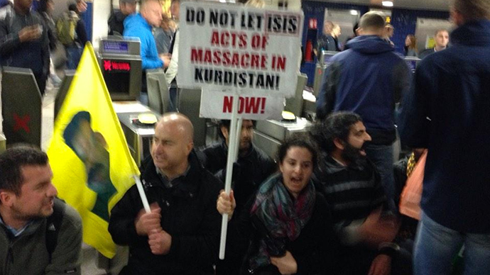 ​'Unite against ISIS!' Kurds occupy London's busiest Tube station
