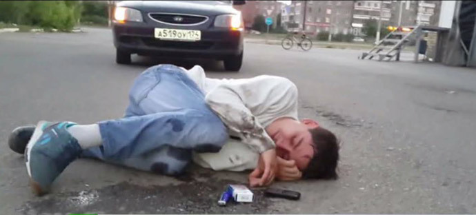 Young man unconscious after inhaling 'spice' fumes. Video still from YouTube