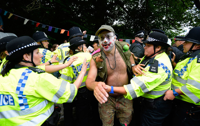 Police scuffle with a demonstrator outside a drill site run by Cuadrilla Resources, near Balcombe in southern England. (Reuters / Paul Hackett)