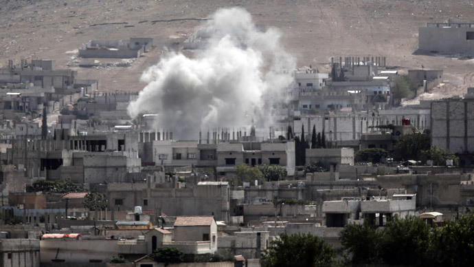 Smoke rises from the Syrian town of Kobane, seen from near the Mursitpinar border crossing on the Turkish-Syrian border in the southeastern town of Suruc, Sanliurfa province, on October 3, 2014.(AFP Photo / Bulent Kilic)
