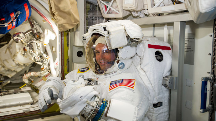 NASA astronaut Reid Wiseman checks his spacesuit in preparation for the first Expedition 41 spacewalk in this image released on October 7, 2014.(Reuters / Alexander Gerst)