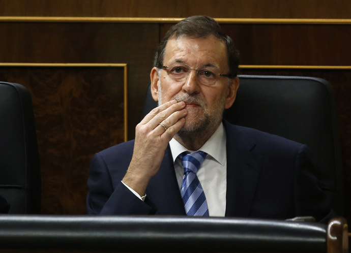 Spain's Prime Minister Mariano Rajoy gestures during a parliamentary session in Madrid, October 8, 2014. (Reuters/Andrea Comas)