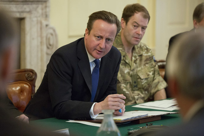 Britain's Prime Minister David Cameron (L) speaks during a Cobra meeting. (Reuters/Neil Hall)