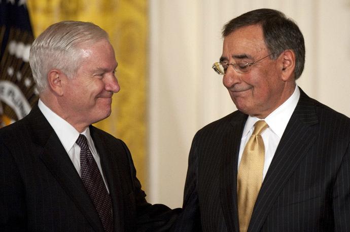 US Secretary of Defense Robert Gates (L) congratulates CIA Director Leon Panetta (R). (AFP Photo/Jim Watson)