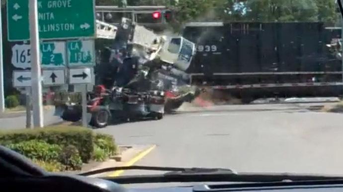 Truck torn apart by 2 trains at rail crossing in Kazakhstan (VIDEO)