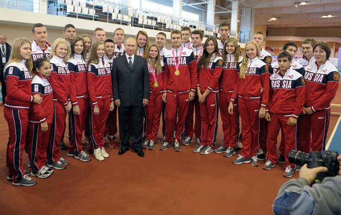 Russian President Vladimir Putin talks to the winners of the 2014 Summer Youth Olympics in Nanjing during a visit to Youth Olympic School No. 3 in Cheboksary on October 9, 2014. (RIA Novosti / Alexei Druzhinin)