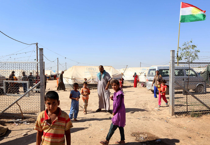 Displaced Iraqis, who had fled their homes after an offensive led by the Islamic State (IS) jihadist group, gather near tents provided by the United Nations High Commission for Refugees (UNHCR) at the Ayden camp, an extension of the larger Aliama camp, in the town of Khanaqin, 160 kms northeast of Baghdad (AFP Photo / Safin Hamed)
