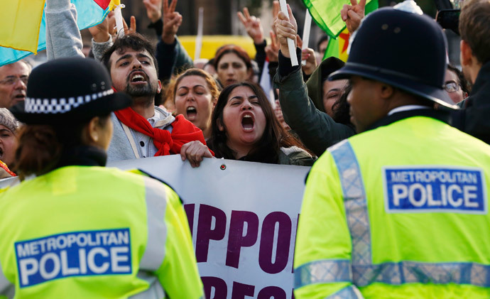 Kurdish demonstrators and supporters protest outside the Houses of Parliament in London October 8, 2014. (Reuters / Luke MacGregor)