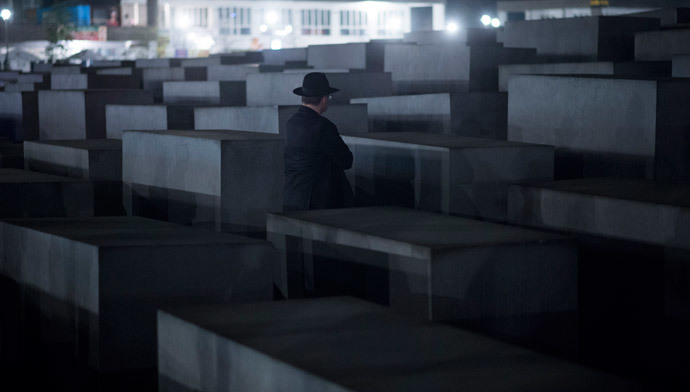 A Rabbi stands in front of a cement stele of the Holocaust Memorial to the Murdered Jews of Europe during a march from the Brandenburg Gate in Berlin. (AFP Photo / Johannes Eisele)