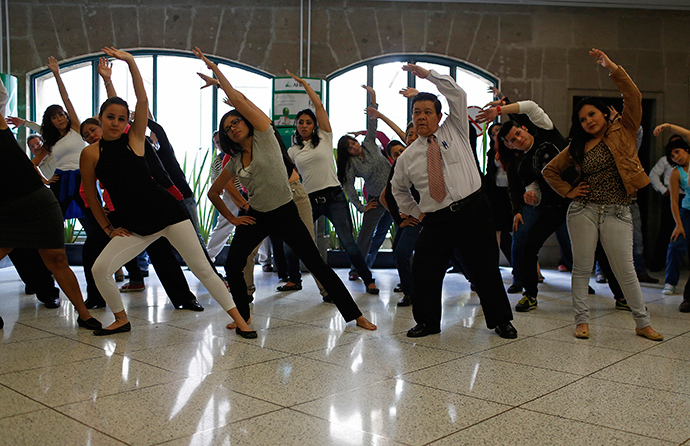 Local government employees participate in a mandatory physical activity session at their office in downtown Mexico City (Reuters)