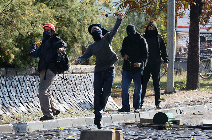 Protesters throw stones as they clash with Turkish riot police during a pro-Kurdish demonstration at the Middle East Technical University (ODTU) in Ankara October 9, 2014 (Reuters / Stringer)