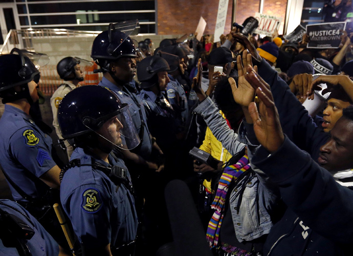 Protesters stand-off against police during a protest in Ferguson, Missouri October 10, 2014. (Reuters / Jim Young)