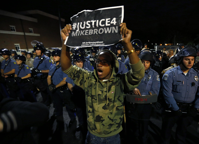 A protester demonstrates in front of a police line in Ferguson, Missouri October 10, 2014. (Reuters / Jim Young)