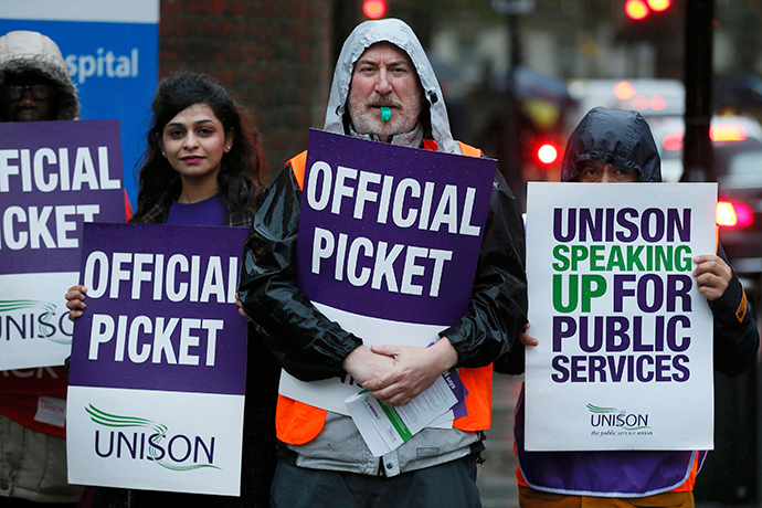 NHS workers hold placards during a strike, outside St Pancras Hospital in London October 13, 2014 (Reuters / Stefan Wermuth)