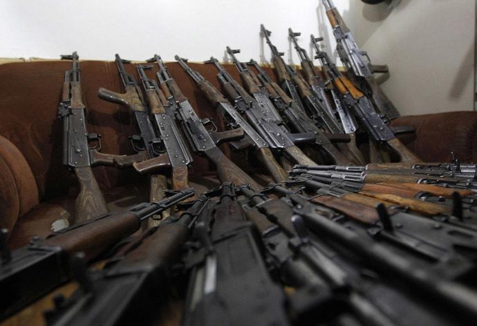 AK-47 weapons (Reuters/Omar Sobhani)