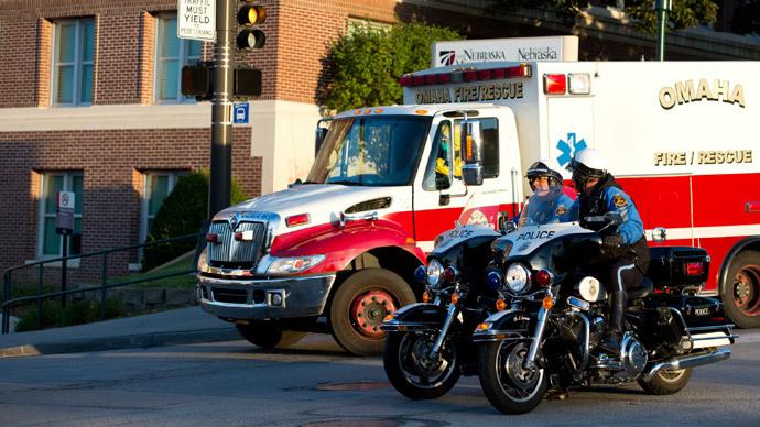 An ambulance transports Ashoka Mukpo, a freelance cameraman who contracted Ebola in Liberia, to the Nebraska Medical Center in Omaha, Nebraska, October 6, 2014.(Reuters / Sait Serkhan Gurbuz)