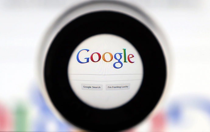 A Google search page is seen through a magnifying glass (Reuters / Francois Lenoir)