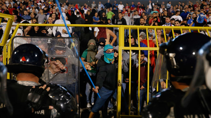 Fans of Serbia face the riot police during the Euro 2016 Group I qualifying soccer match between Serbia and Albania at the FK Partizan stadium in Belgrade October 14, 2014.(Reuters / Marko Djurica)