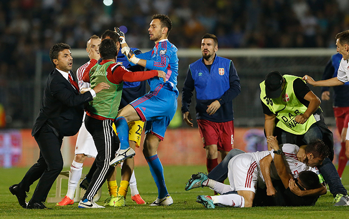 Fans and players of Serbia and Albania scuffle during their Euro 2016 Group I qualifying soccer match at the FK Partizan stadium in Belgrade October 14, 2014. (Reuters / Marko Djurica)
