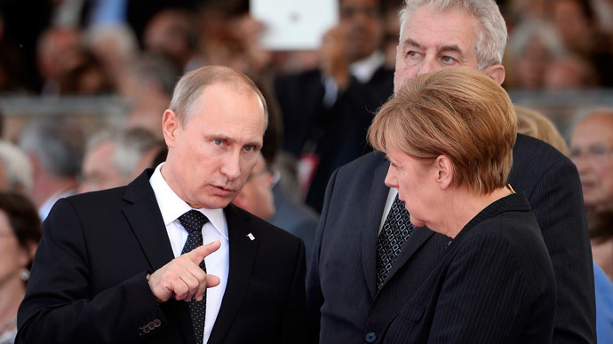 Russian President Vladimir Putin and German Chancellor Angela Merkel chat at the international D-Day commemoration ceremony in Normandy, on June 6, 2014.(AFP Photo / Alain Jocard)