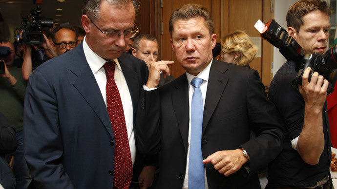 Gazprom CEO Alexey Miller (C) leaves after talks on energy security between EU-Commissioner for Energy, Russian Energy Minister and Ukrainian Energy Minister on September 26, 2014 in Berlin.(AFP Photo / Odd Andersen)