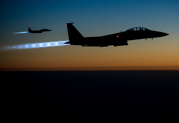 A pair of U.S. Air Force F-15E Strike Eagles fly over northern Iraq after conducting airstrikes in Syria, in this U.S. Air Force handout photo taken early in the morning of September 23, 2014 (Reuters / HO)