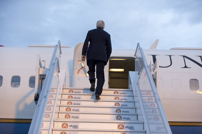 U.S. Secretary of State John Kerry board his plane at Orly Airport. (Reuters/Carolyn Kaster)