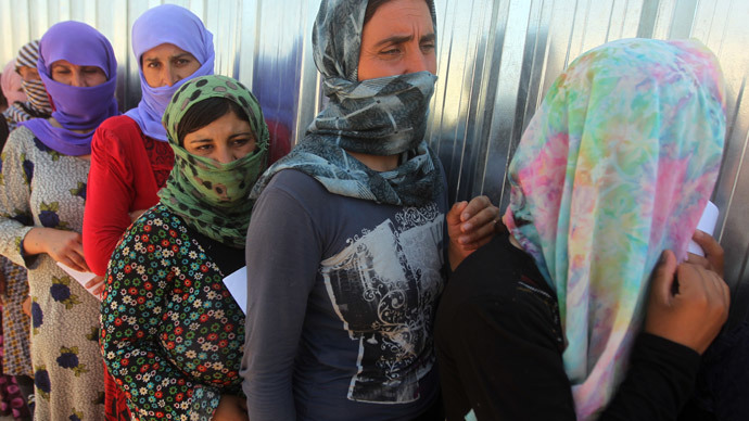 'Can one take 2 slave girls?' ISIS militants joke about selling Yazidi women (VIDEO)