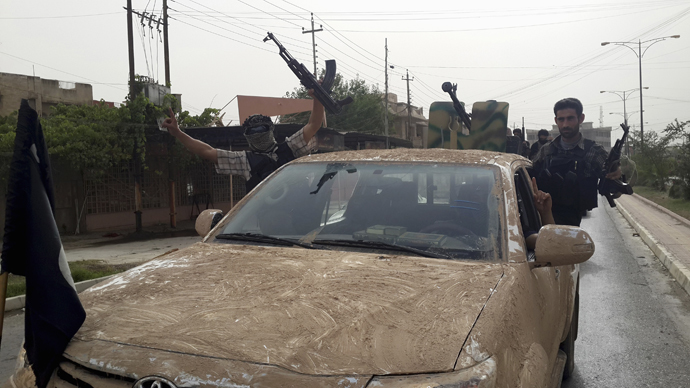 Fighters of the Islamic State of Iraq and the Levant (ISIL) celebrate on vehicles taken from Iraqi security forces, at a street in city of Mosul, June 12, 2014. (Reuters/Stringer)