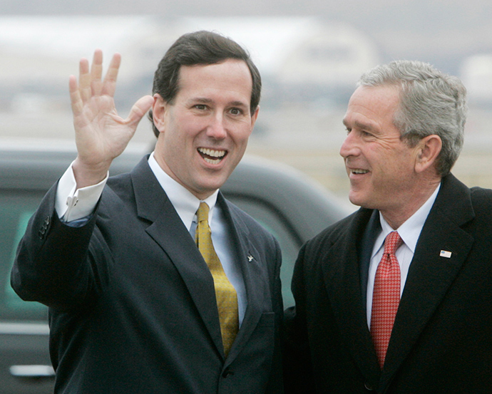ARCHIVE PHOTO: U.S. President George W. Bush (R) is met by U.S. Senator Rick Santorum (R-Pa) after Bush arrived on Air Force One in Pittsburgh, March 24, 2006 (Reuters / Larry Downing)