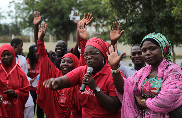 "Campaigners from ""#Bring Back Our Girls"" gesture during a rally calling for the release of the Abuja school girls who were abducted by Boko Haram militants, in Abuja October 17, 2014 (Reuters / Afolabi Sotunde)"