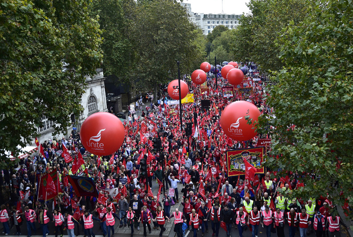 Thousands of protestors march along Victoria Embankment in central London, October 18, 2014. (Reuters / Toby Melville)