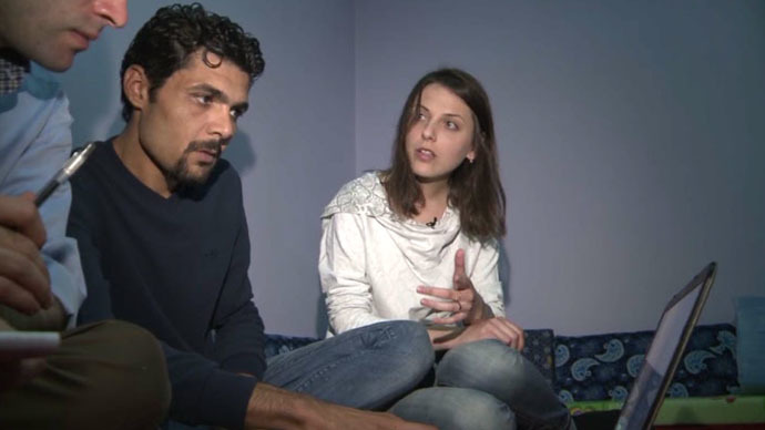 Bazran Halil, a Kurdish rights activist and journalist, and his wife Raushan. Still from RT video
